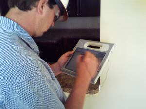 A Doster Construction employee utilizes an F5 tablet PC on the jobsite.