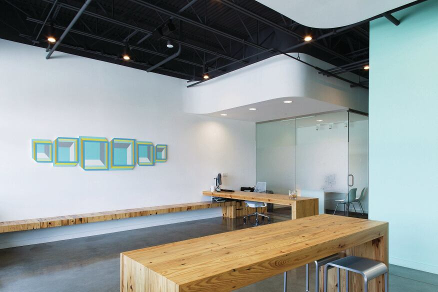 Custom furnishing and artwork define the renovated offices of KC Dental Works.