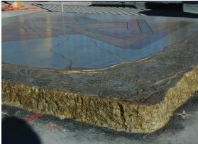 Gasser demonstrates what can be done with old, worn slabs that might be considered past their usefulness. He used epoxy, stains, overlay cements, and decorative grinding.