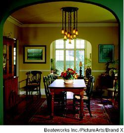A new arched opening between the dining room and sunroom mirrors an existing arch, deferring to the old house while bringing extra daylight inside.