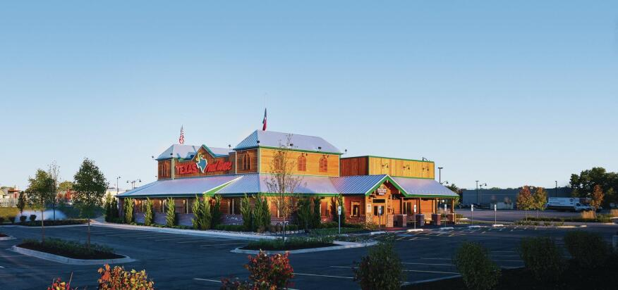 A freestanding version of a Texas Roadhouse (the chain's preferred typology) in Countryside, Ill. Designed by GreenbergFarrow, this location opened in September 2013.