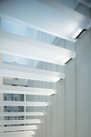 LEDs are notched into the stairwell treads giving them a soft glow.