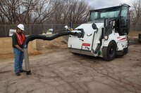 Front debris hose option available for sweeper