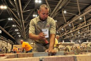 Christian Rodriguez works to complete his composite project at the National Masonry Championships held in conjunction with the 48th annual SkillsUSA National Leadership and Skills Conference, held at H. Roe Bartle Convention Center in Kansas City, Mo.