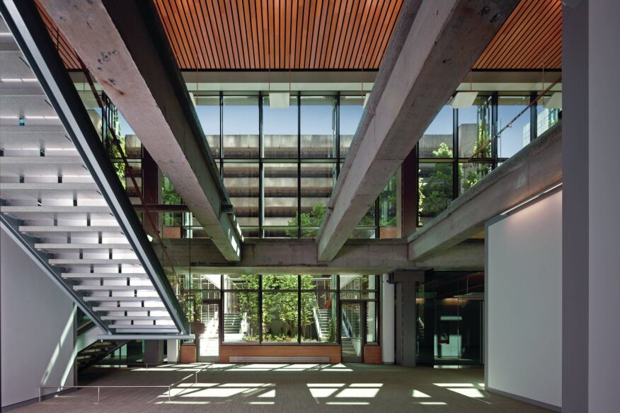 With entrances on two levels, there was an opportunity to create a double-height public space at the base of the building. Sections of the existing floor slab were removed to bring daylight from the upper, plaza level to the lower, ground level, which has been reconfigured with conference space.