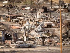 Scorched cars and trailers burned by the Blue Cut fire line a residential street in Phelan, Calif., on Friday, Aug. 19, 2016.