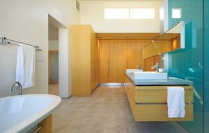 Part of the bath's serene solution is ample storage.