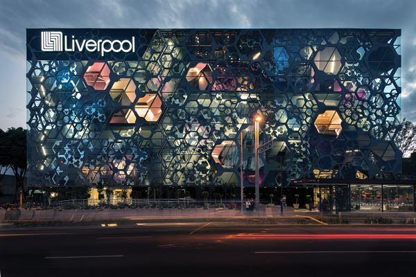 At night, the hexagonal pods that form the façade extension are lit from within by neon strip lights embedded into the gypsum walls. The unoccupied sections are lit as well, showcasing the three-dimensionality of the structure.