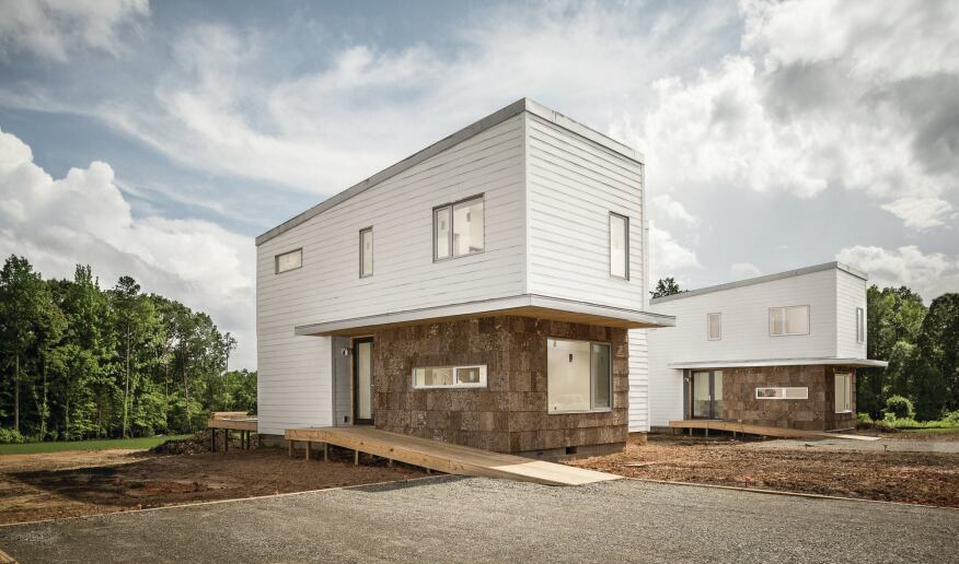 The neighboring prefab houses in South Boston, Va., look identical, but the left EcoMod prototype is built to Passive House standards, while the right unit is built to code only. John Quale and his team are monitoring their energy performance under occupancy.