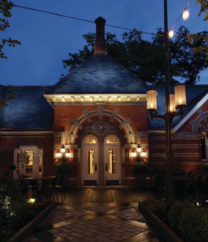 To create the look of moonlight on the roof, an exterior-rated floodlight with a blue filter and a metal halide pattern projector are used. Inground uplights and wall sconces highlight the architectural details of the brick façade.