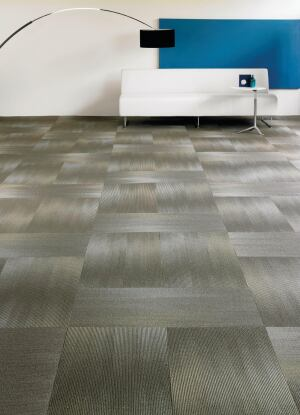 "Manufactured by Shaw Contract Group, 18X36 is a rectangular carpet tile on EcoWorx backing that contains 40% pre-consumer recycled content and can be recycled by Shaw at no cost at the end of its lifetime. The surface is made of Eco Solution Q nylon, which contains 25% pre-consumer recycled content, and is completely recyclable into new nylon. Tiles in the collection come in a unique shape (18"" wide by 36"" long) and in five patterns: fade, blur, overlay, laser cut, and scale. shawcontractgroup.com"