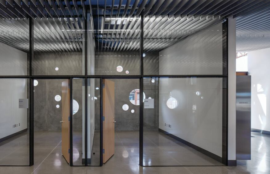 Offices, however, are enclosed in glass walls to promote a sense of procedural transparency.