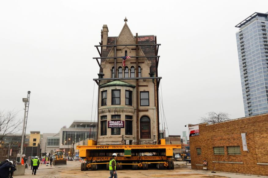 Crews watch as the Harriet F. Rees House, built in 1888, is slowly moved 600-feet to its new location.