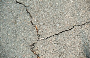 Old asphalt pavement with cracks after frost damage