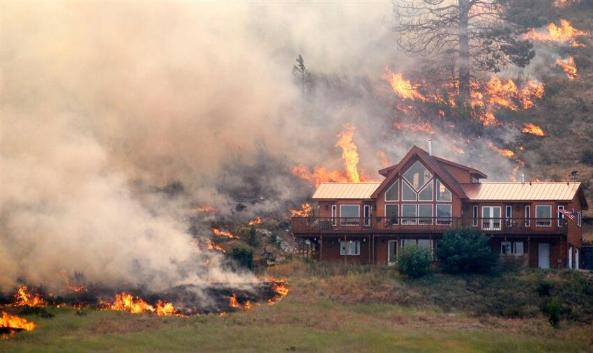 Proper product selection and site location saved this house from an August 2012 wildfire.