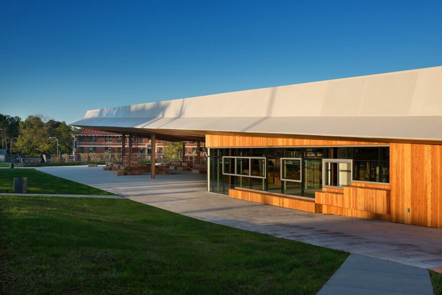 A enclosed space at the rear of the pavilion holds a community room, restrooms, and a cafe.