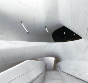 At the center of the building is a curvaceous atrium with a staircase leading to the second-level galleries.