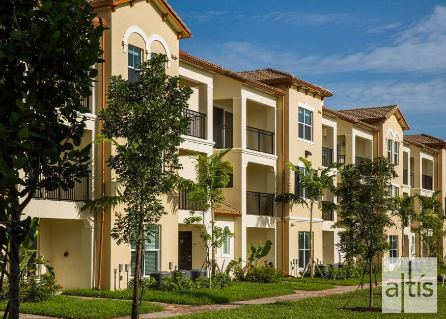 Private entries, as well as attached garages at many units, are among the features intended to make the three-story buildings at the Pembroke Pines development feel homier than traditional low-rise multifamily properties.