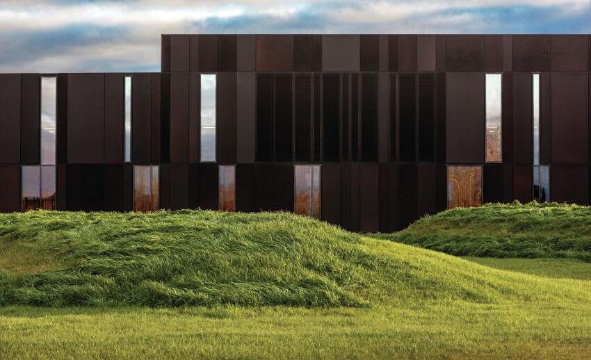 The aluminum and glazed skin was informed by the surrounding tree-lined landscape.