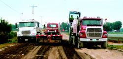 During construction on County Trunk Highway S in northwestern Racine County, Wis., construction crews travel on recycled base stabilized with fly ash.