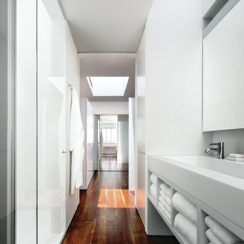 A galley-style bathroom cuts through the second floor, culminating in a master bedroom and dressing room in the more opaque southern end of the house.