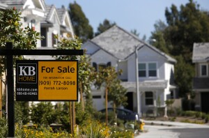 """A """"For Sale"""" sign is displayed in front of a house at the KB Home's Whisler Ridge housing community in Lake Forest, California, U.S., on Monday, Sept. 23, 2013. KB Home, a U.S. homebuilder that targets first-time buyers, reported third-quarter earnings that beat analyst estimates as prices and sales jumped. Photographer: Patrick Fallon/Bloomberg via Getty Images"""