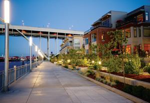 CITY MIX: The inhabitants of Riverscape townhomes are a diverse lot, including single  professionals, young married couples, families with small children, and empty-nesters.
