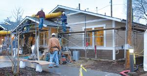 Lending a helping hand, students from California State University, Chico's Concrete Industry Management program constructed two homes.