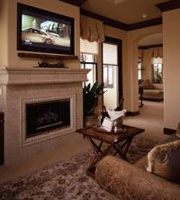 In the master bedroom, Best Buy's 42-inch plasma TV takes pride of place above a cast-stone fireplace mantel and surround from Realm of Design.