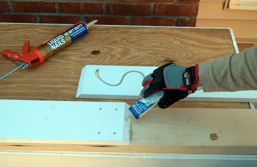 After locking the first length of trim in place with two pairs of countersunk trim screws, the author applies PVC adhesive to one face of the lap joint, which he cuts at a 45-degree bevel.