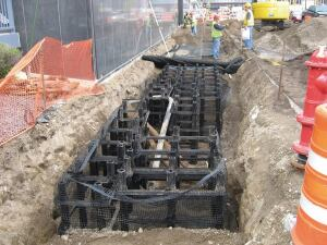 DeepRoot Partners. The Silva Cell modular system holds soil for tree growth and stormwater management while supporting paved surfaces. The system holds 10 cubic feet of soil per unit, protecting tree roots from compaction and providing room for stormwater infiltration and surrounding utilities. The 48-by-24-by-16-inch fiberglass and polypropylene cells have galvanized steel supports and can be stacked up to three cells high and laterally as wide as necessary before the decking is attached. 800.458.7668. www.deeproot.com.