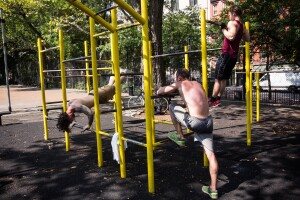 NEW YORK, NY - SEPTEMBER 02:  Men excercise on bars in Tompkin Square Park on September 2, 2014 in New York City. After an unusually cool summer, temperatures are supposed to hit the high 80s this week.  (Photo by Andrew Burton/Getty Images)