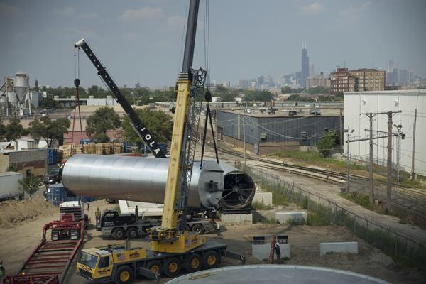 Cranes move the digester tubes into place.
