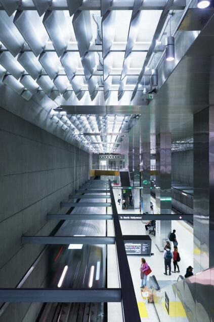 The underground rail station receives ample light from above.