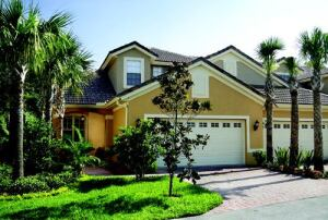 ACTION-PACKED PLAN: The 2,240-square-foot Allamanda plan, the most popular choice at The Sabals, features a two-car garage, a first-floor master suite, a screened lanai, and vaulted ceilings in the living and dining rooms.