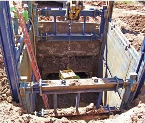 Although more labor intensive than tunneling, a slide-rail trenching system kept the Fort Collins, Colo., stormwater-pipeline project within its $35 million budget.