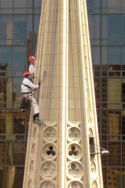 Workers survey the condition of a cathedral tower.