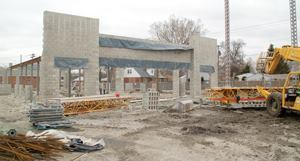 After being idle for several months, masons have started to work on this 10,000-square-foot strip shopping center project in Chicago.