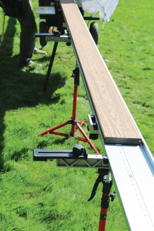 FastCap's optional molding stop is used here to keep the decking from sliding off the fence.