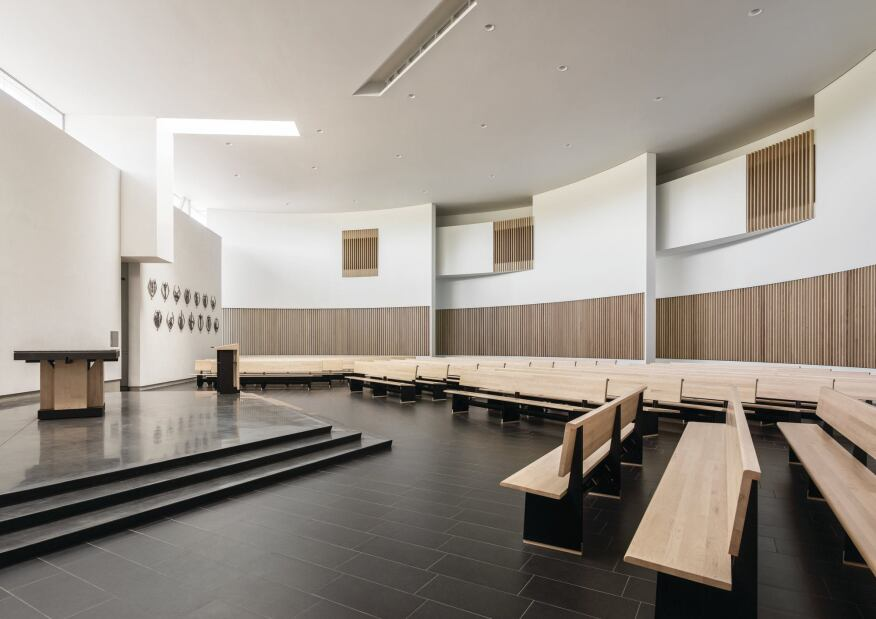 The main sanctuary features a custom altar and pews, also designed by Hodgetts +   Fung, as part of the firm's holistic approach. Ash wood slats act as both acoustic baffles and HVAC grilles.