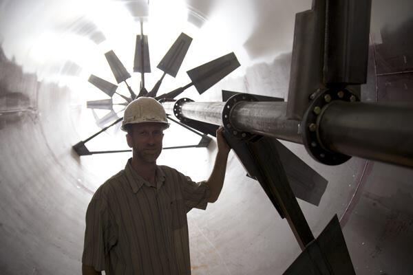 The Plant's executive director, John Edel, inside the 104-foot-long digester tube.