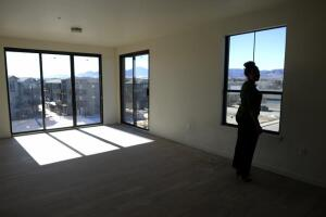 BOULDER, CO - JANUARY 28: Leasing agent Carina Gilford looks out of the window of a three-bedroom apartment at the Gunbarrel Center, which is a 200-plus unit complex with retail spaces beneath some residences. The property was photographed on Thursday, January 28, 2016. Broomfield and Boulder are seeing new apartment construction, which are high-end and getting harder to fill. (Photo by AAron Ontiveroz/The Denver Post)