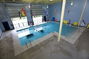Swim school offers free lessons for children with autism for Little fish swim school