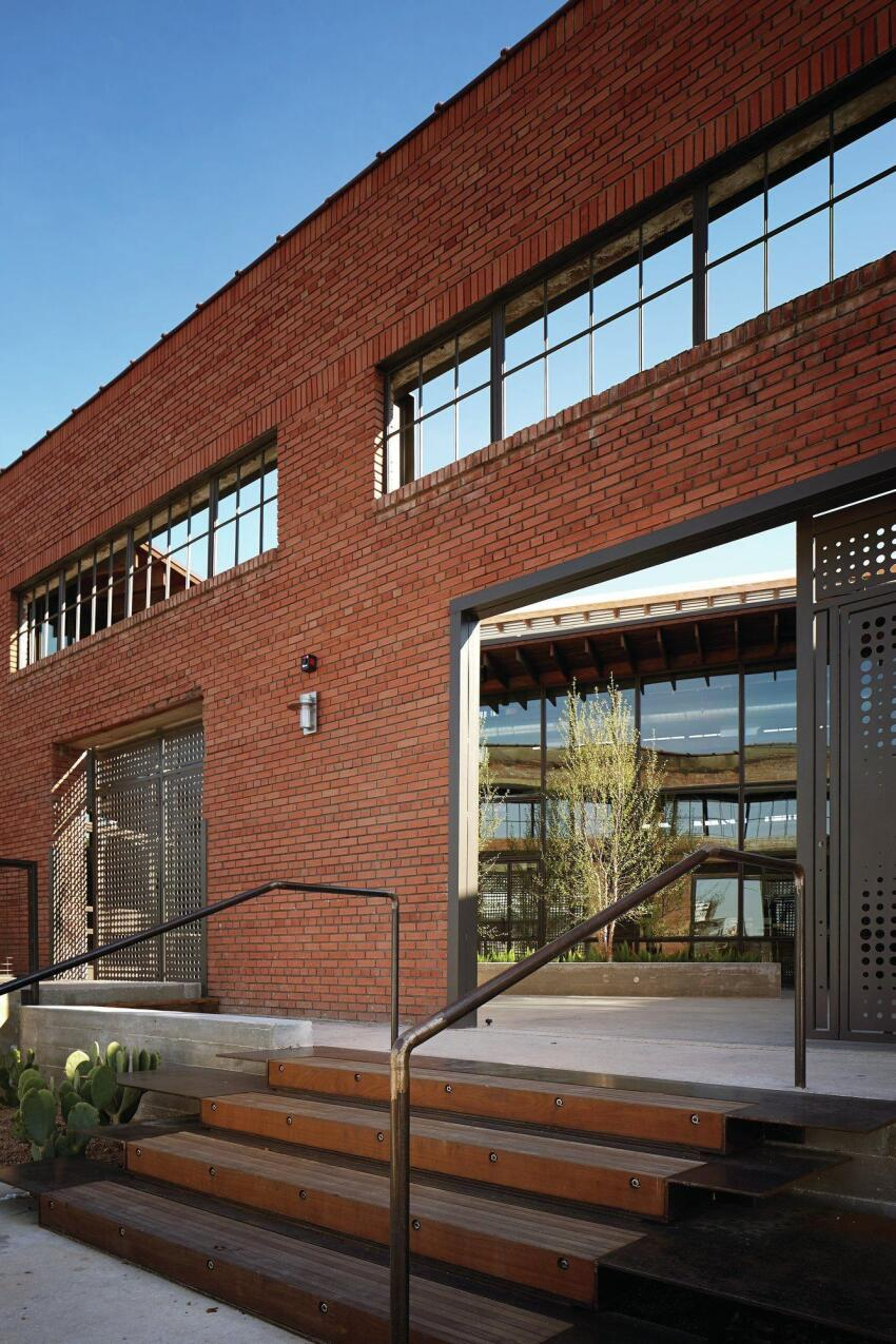 Overland Partners filled three loading dock bays with perforated steel on the street façade.