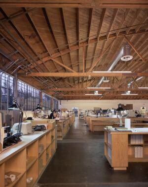 Marmol Radziner's primary office is a 17,000-square-foot 1950s bowstring truss shed featuring drafting table desks for more than 80 architectural staff.