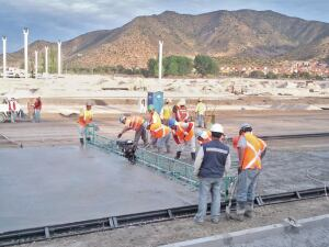 Truss screeds that ride on edge forms or screed rails often are used in paving applications.