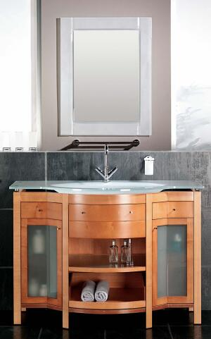 The Venecia line, like all of Sonia's bath furniture, is constructed from marine-grade wood for greater water resistance. With its open shelves, side cubbies behind glass doors, and shallow drawers for easy reaching, the curved Venecia features plenty of storage options. High-pressure-formed sink/counter combos come in snowy or frosted glass as well as white fire clay. Select beech or wenge-wood finishes. Sonia, S.A., 954.572.5454  www.sonia-sa.com
