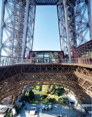 The first-floor renovation includes the demolition and rebuilding of the Pavillon Ferrié (center) and a new exterior for the Pavillon 58 Tour Eiffel (right), whose interior was updated by French designer Patrick Jouin in 2009.