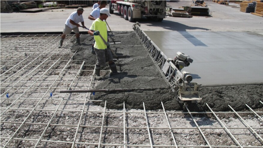 During placement, a vibrating screed travels along the screed pipe, for precise elevation control.