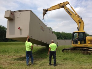A tiny town takes delivery of a turnkey sewer system that conveys primary-treated effluent, without manholes or lift stations, to a two-stage treatment facility.